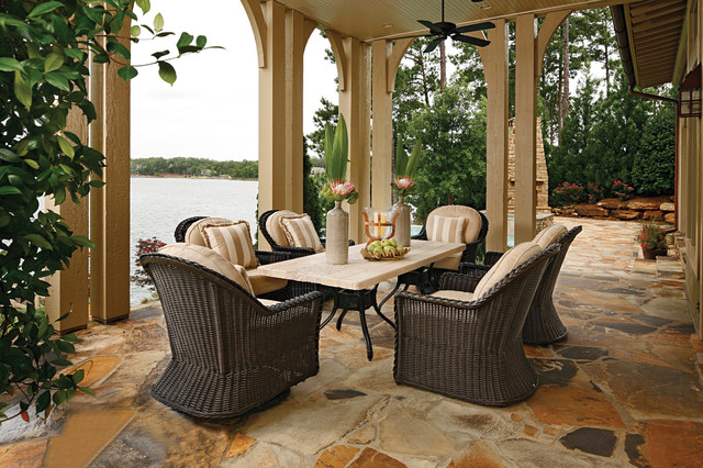 Euro height outdoor wicker chairs and stone patio table Traditional Patio