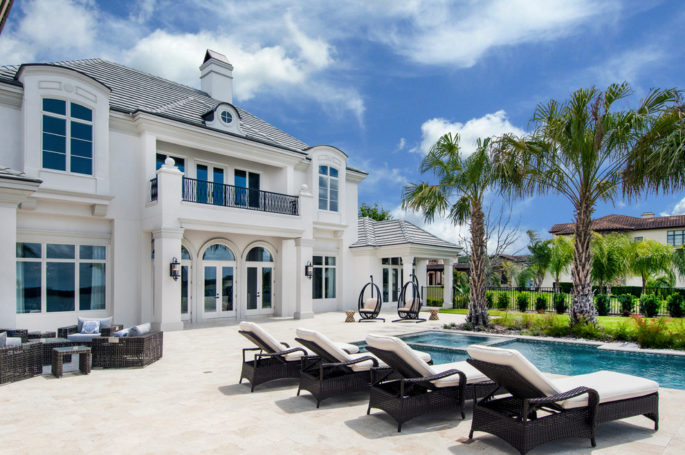 Inspiration for a timeless backyard stone patio remodel in Tampa with no cover