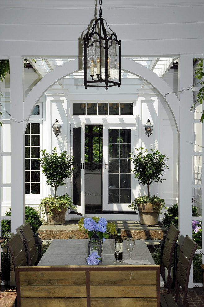 Inspiration for a large timeless backyard patio remodel in New York with a roof extension and a fire pit