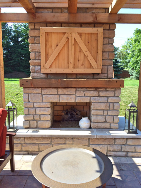 Farmhouse outdoor fireplace with custom cedar tv cabinet ...