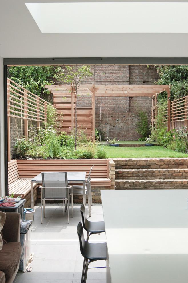 Patio - mid-sized contemporary backyard patio idea in London