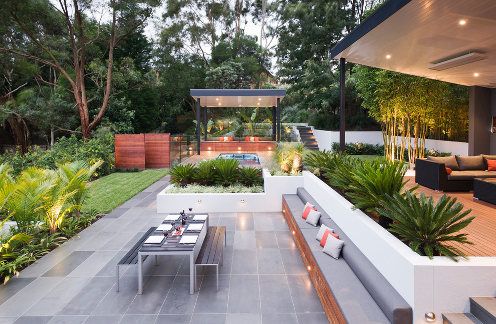 Patio kitchen - large contemporary backyard patio kitchen idea in Melbourne with decking and a gazebo