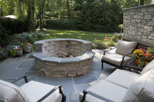 trendy backyard stone patio photo in chicago with a fire pit - Fire Pit Patio