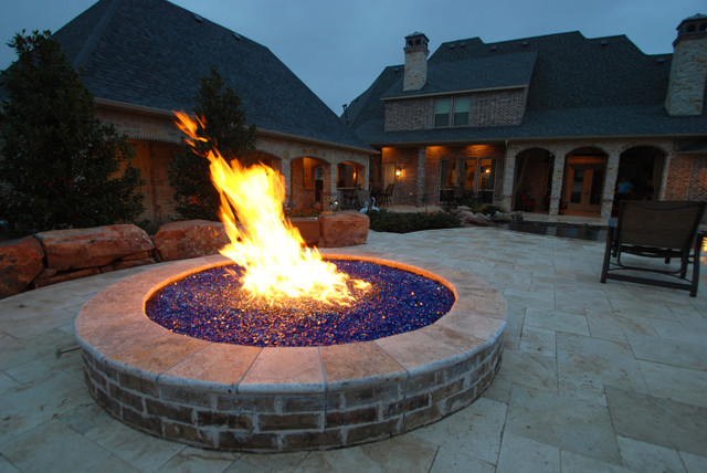 Tuscan patio photo in Dallas - Fire Pit With Blue Glass Rocks - Mediterranean - Patio - Dallas - By