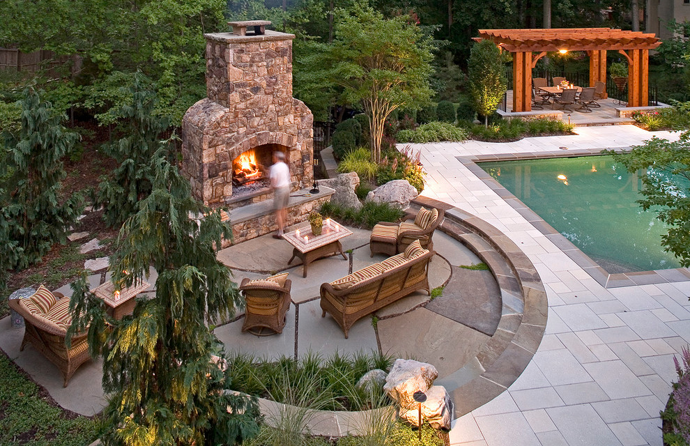 Inspiration for a large timeless backyard stone patio remodel in DC Metro with a fire pit and no cover