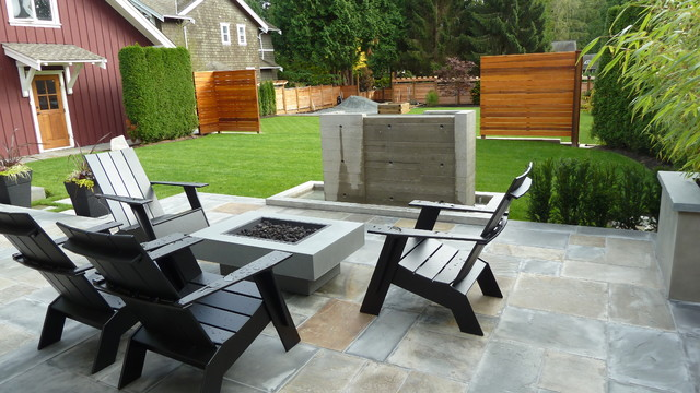 Patio - mid-sized craftsman backyard stone patio idea in Vancouver with a fire pit and a roof extension