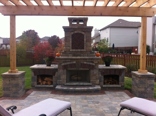 Example of a trendy patio design in Chicago - Fireplace And Pergola