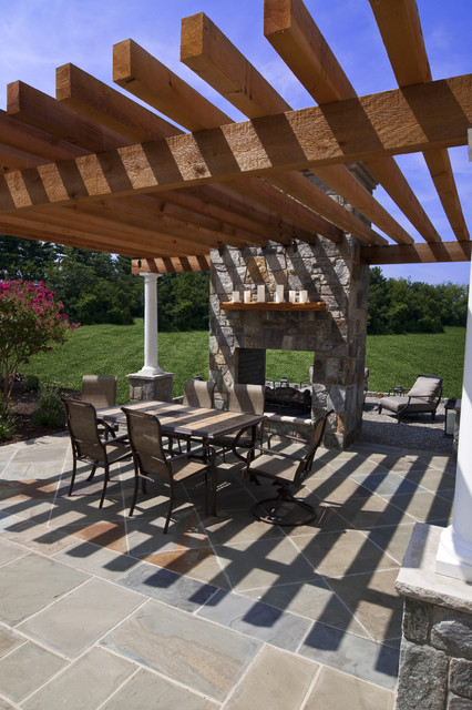 Flagstone dining patio with pergola and fireplace traditional-patio