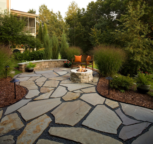 Flagstone patio and natural stone fire pit traditional for Flagstone patio designs