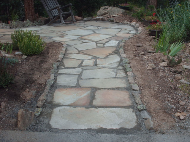 Flagstone patio in Kittredge, Colorado.  By Mountaineer Landscaping and Painting traditional-patio