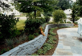 Flagstone Patio With Bluestone Retaining Wall Modern