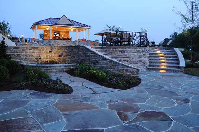Flagstone patio with custom water feature and outdoor lighting traditional patio