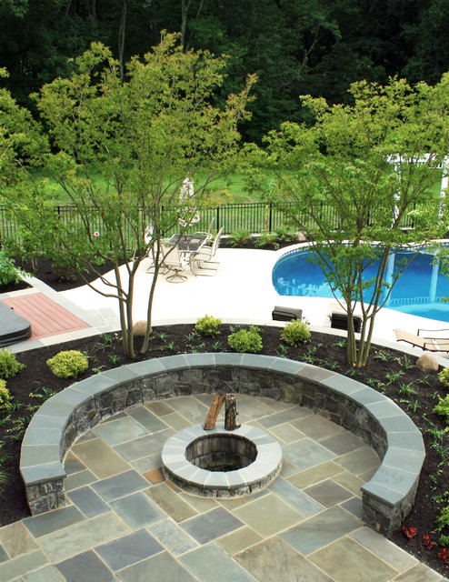 Flagstone patio with firepit tropical-patio