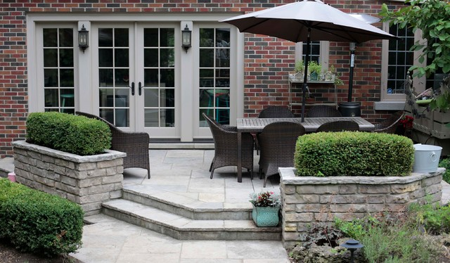 Flagstone Patio With Natural Stone Planters Traditional