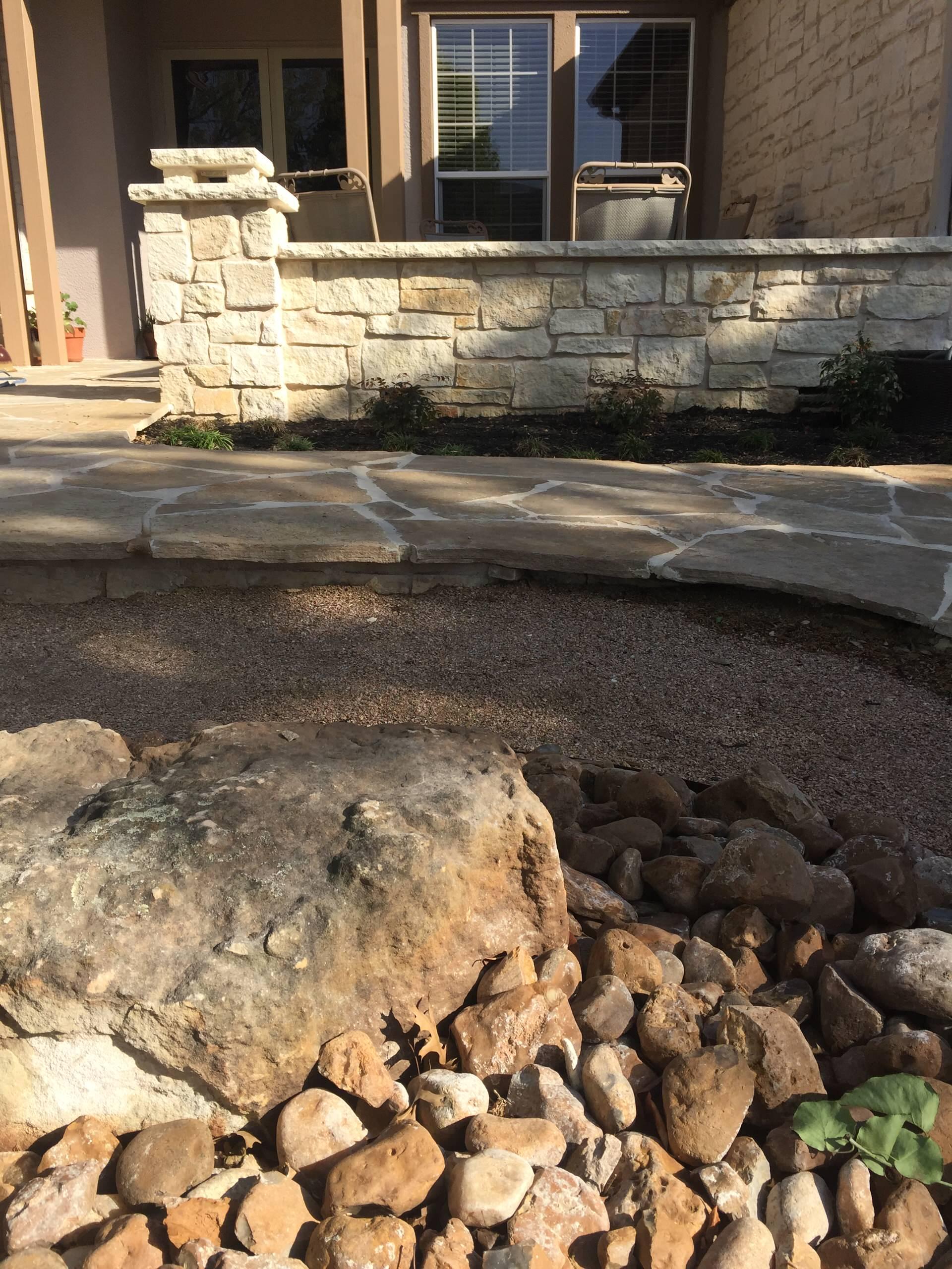 Flagstone sidewalk and entryway w/ custom stone columns and seatwalls