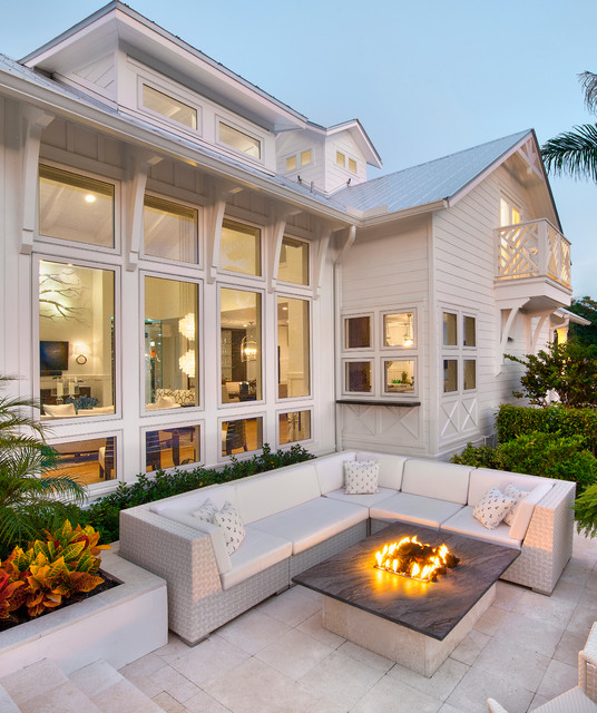 Patio - beach style patio idea in Miami with a fire pit and no cover