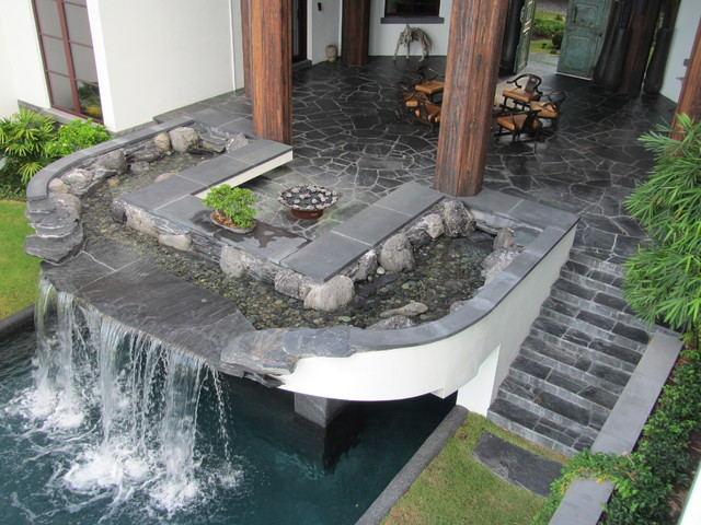 Florida pool waterfall and outdoor living room asian for Garden pool room