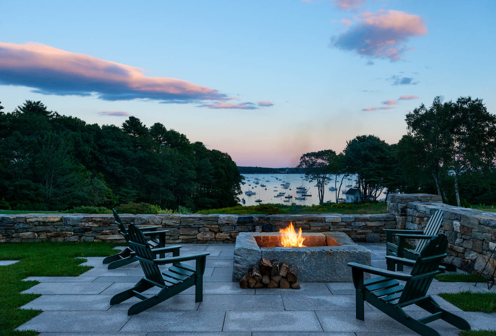 Inspiration for a coastal patio remodel in Portland Maine with a fire pit