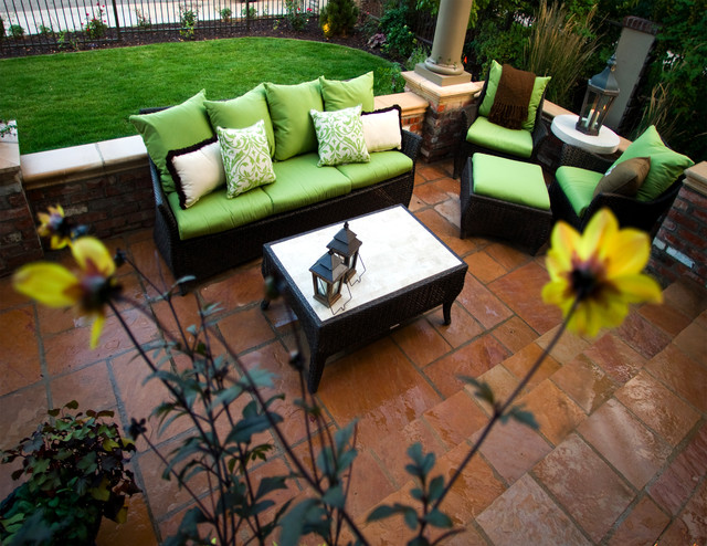 Formal Flagstone Patio with Exclusive Wicker Furniture traditional-patio