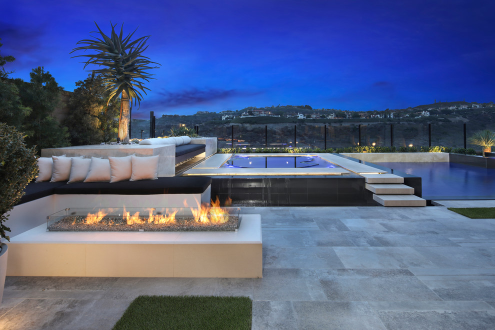 Trendy backyard tile patio photo in Orange County with a fire pit and no cover