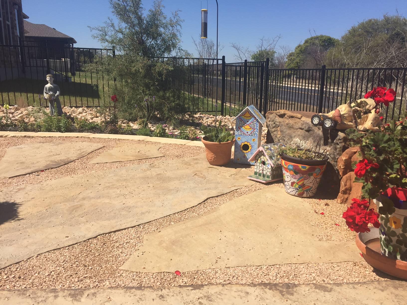 Freestanding flagstone patio w/ decomposed granite and xeriscape