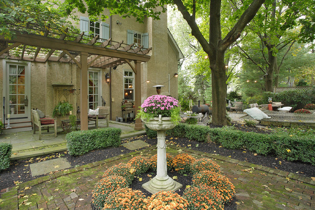 French tudor style home traditional patio