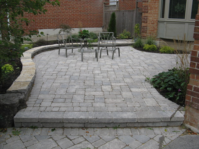 Front Patios Design Ideas image of concrete and brick patio designs Example Of A Tuscan Patio Design In Toronto