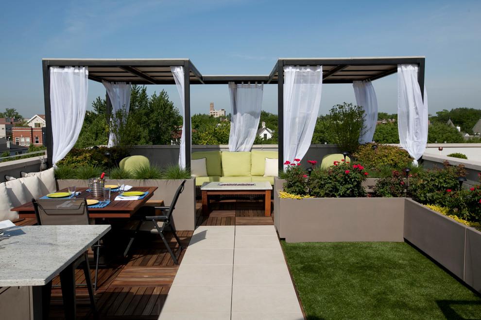 Diseño de patio actual con entablado y cenador