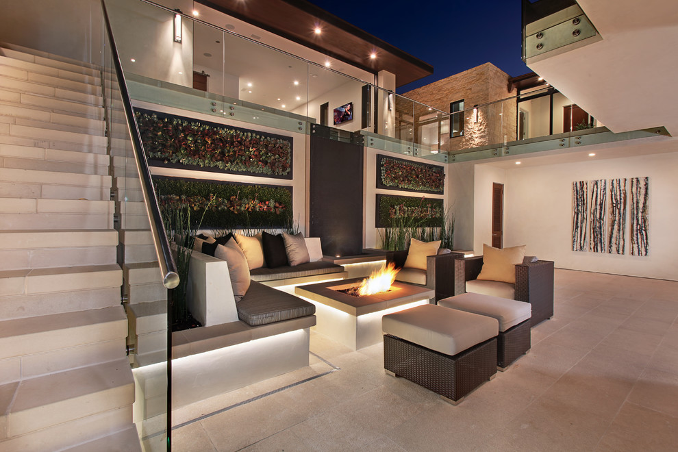 Inspiration for a huge contemporary courtyard concrete paver patio vertical garden remodel in Orange County with no cover