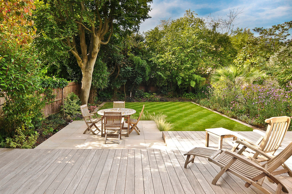 Example of a trendy backyard patio design in London