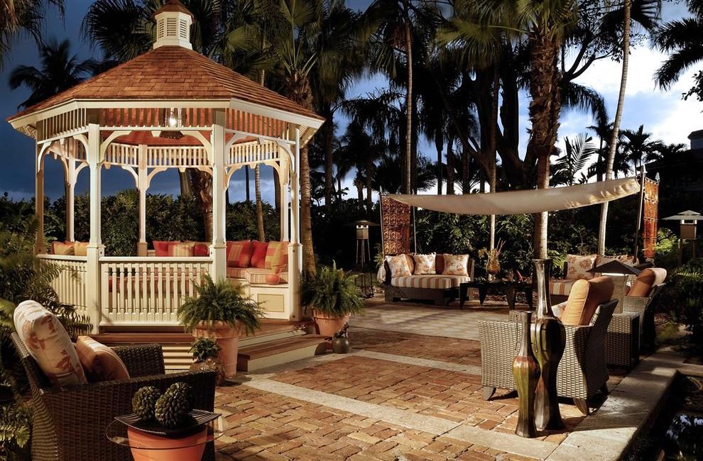 Island style patio photo in Miami with a gazebo