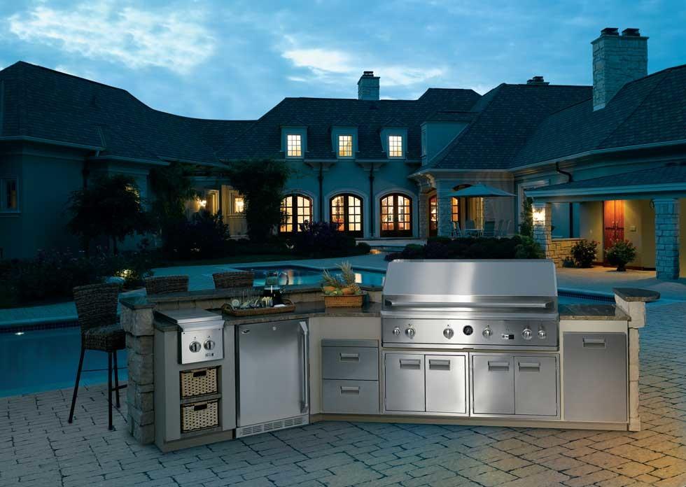 Large elegant backyard brick patio kitchen photo in Other
