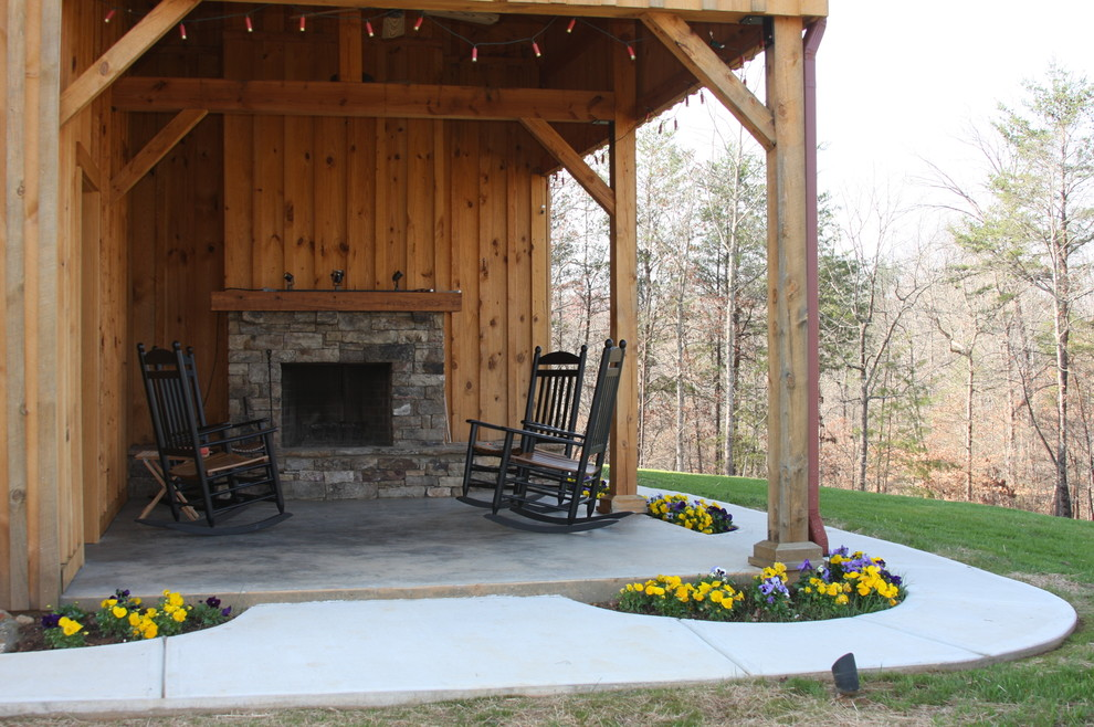 Inspiration for a rustic patio remodel in Other with a fire pit