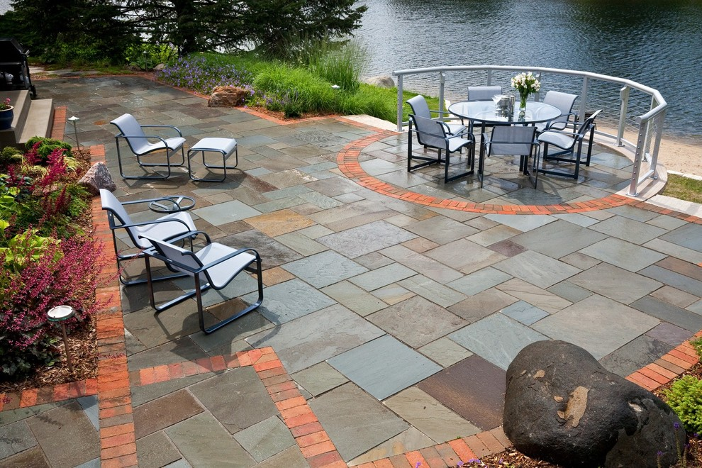 Mid-sized elegant backyard stone patio photo in Milwaukee