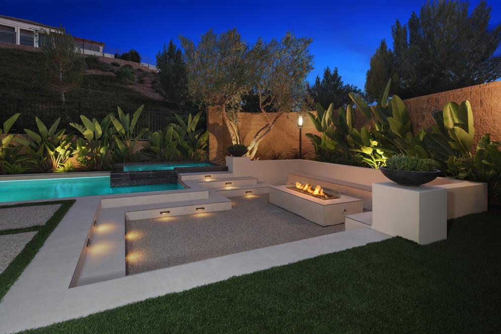 Patio - contemporary concrete patio idea in Orange County with a fire pit