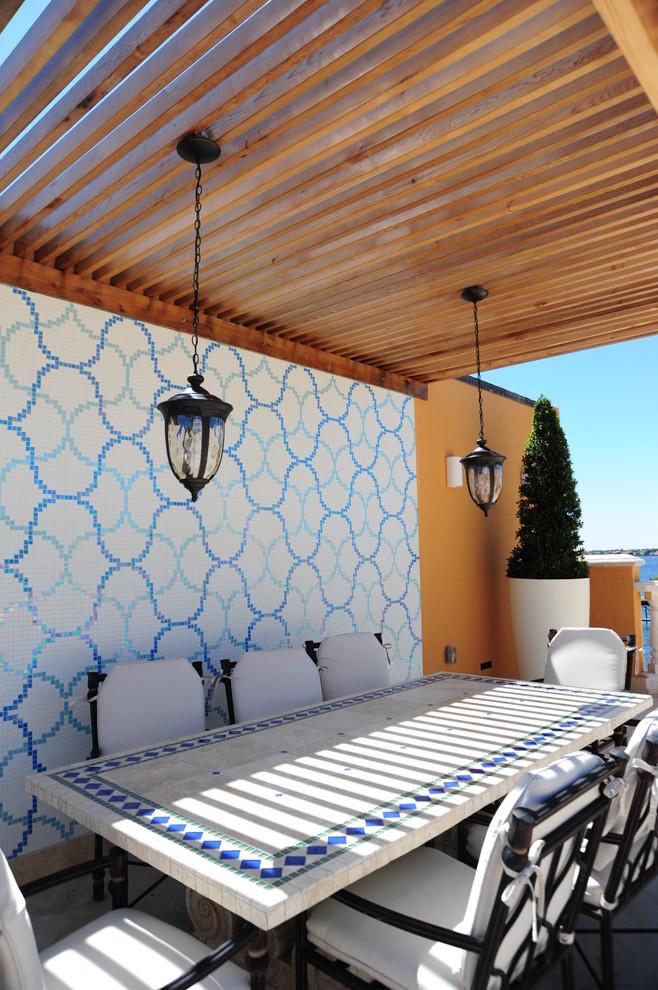 Inspiration for a contemporary patio remodel in Miami with a pergola