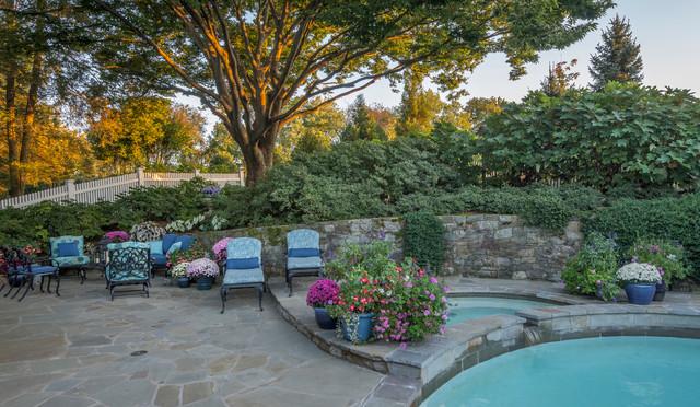 Example of a small trendy backyard stone patio container garden design in DC Metro