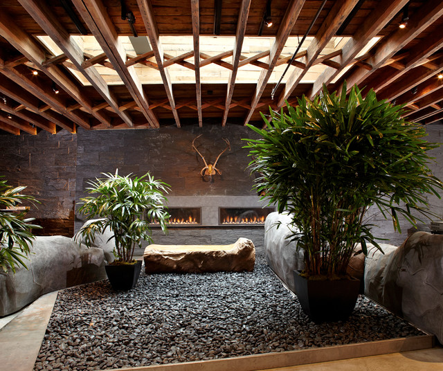 Inspiration for a large modern concrete patio remodel in New York with a roof extension