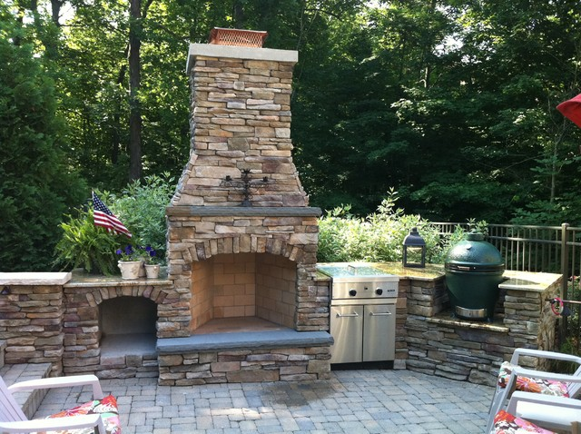 traditional firepits by Signature Outdoor Concepts