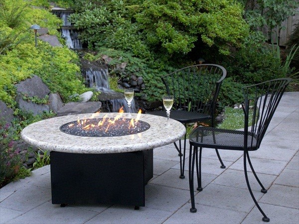 Gas Fire Pit with natural waterfall by Oriflamme Fire Tables.   This amazing photo features the unique propane or natural gas fire pit from All Backyard Fun.