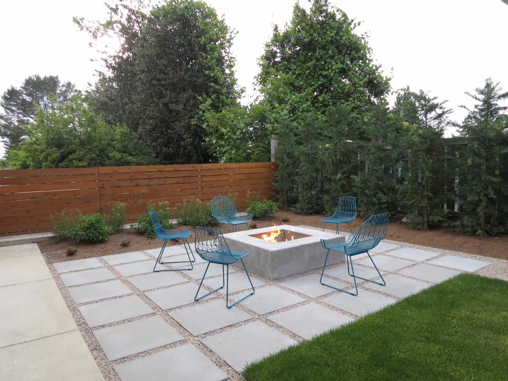 Patio - contemporary backyard concrete paver patio idea in Seattle with a fire pit
