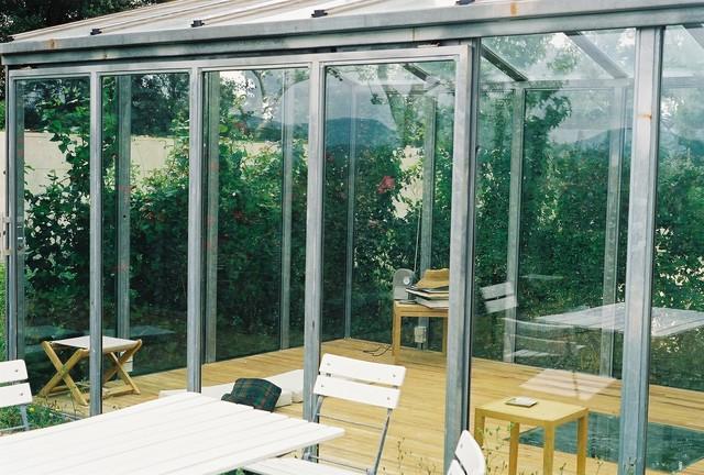 Green study room contemporary-patio