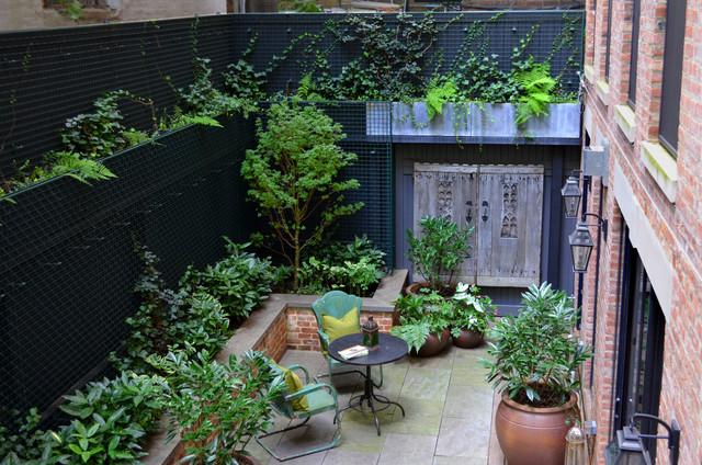 Greenwich Village Backyard transitional-patio