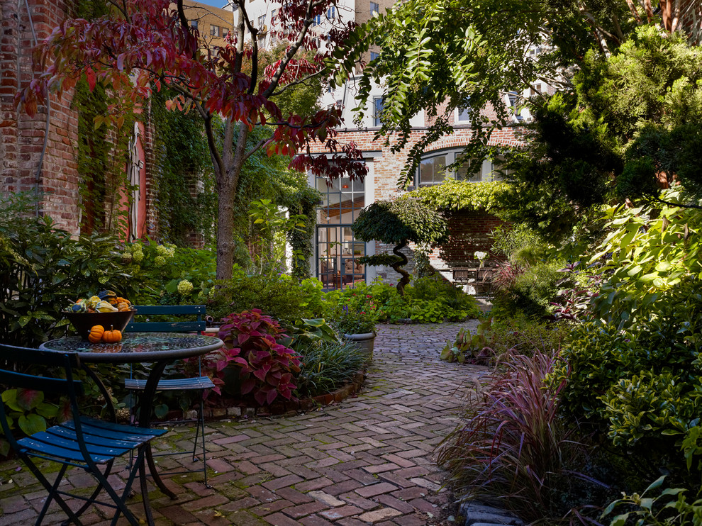Inspiration for an industrial courtyard brick patio remodel in Philadelphia