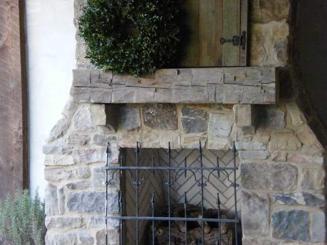 Hand hewn Beam for an Outdoor Fireplace Mantle traditional-patio