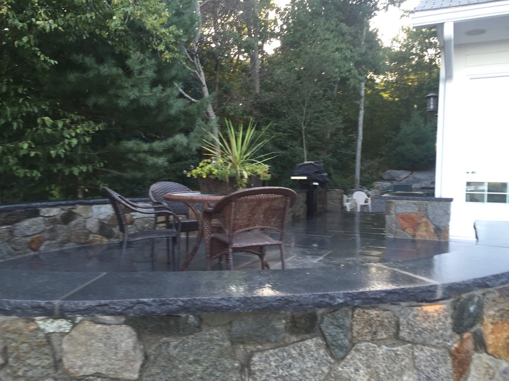Inspiration for a mid-sized modern backyard tile patio remodel in Boston with no cover