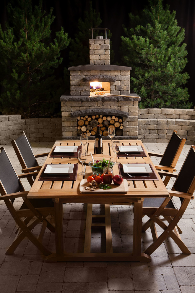 Large elegant backyard concrete paver patio kitchen photo in Other with no cover