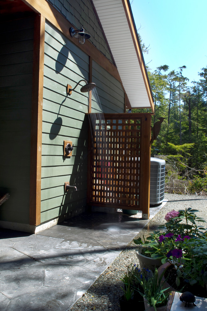 Example of a classic stone outdoor patio shower design in Vancouver