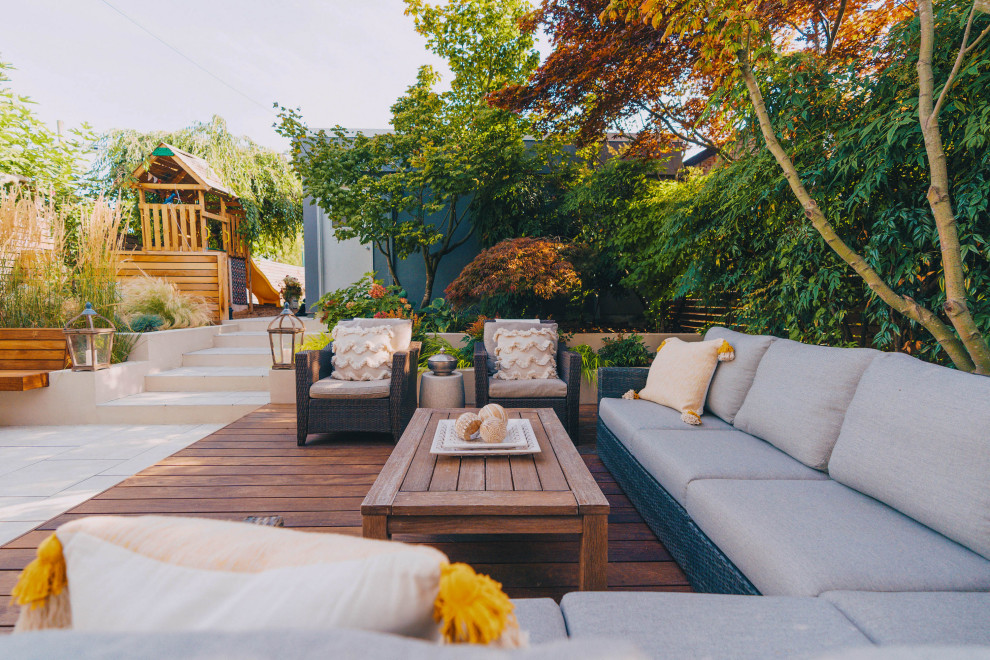 Example of a mid-sized trendy backyard patio design in Vancouver