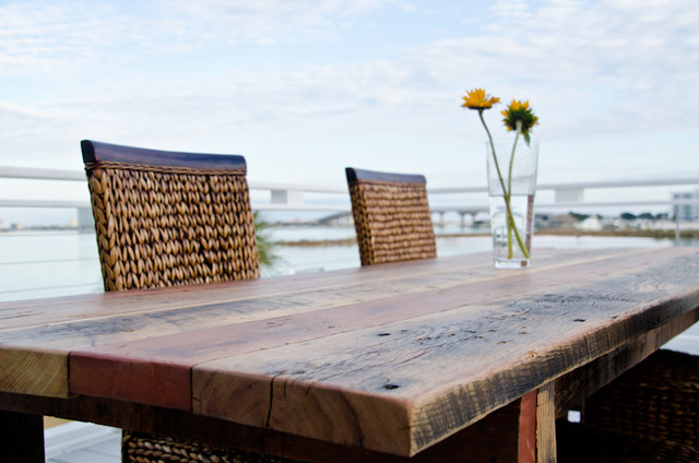 Heart pine dining table up close view beach style patio birmingham by saltaire restoration